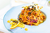 Healthy eating topic: Vegan, organic, gluten free, raw food – Pad Thai with mixed vegetable julienne, thai sauce, and spiced cashews