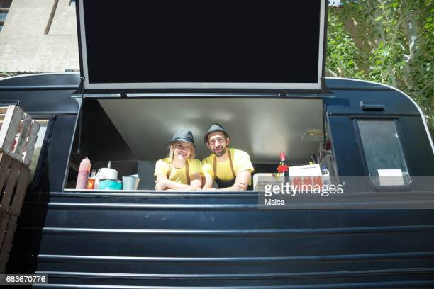 Food truck and happy owners