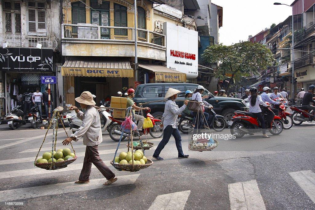 Food venders crossing street in old quarter.