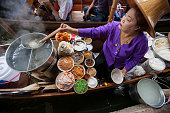 Food vendor at Damnoen Saduak Floating Market, Thailand.