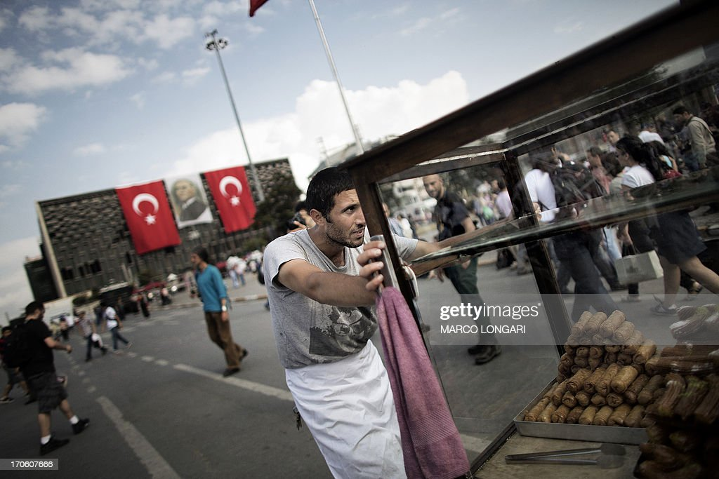 A food vendor pushes his cart in Istanbul's Taksim square, on June 15, 2013. Turkish protesters today refused to budge from an Istanbul park at the centre of nationwide anti-government demonstrations after rejecting a government olive branch aimed at ending two weeks of deadly unrest. The government said it would 'make an evaluation' after protesters rebuffed Prime Minister Recep Tayyip Erdogan's promise to halt the redevelopment of Gezi Park, saying their movement was bigger than a conservation struggle.