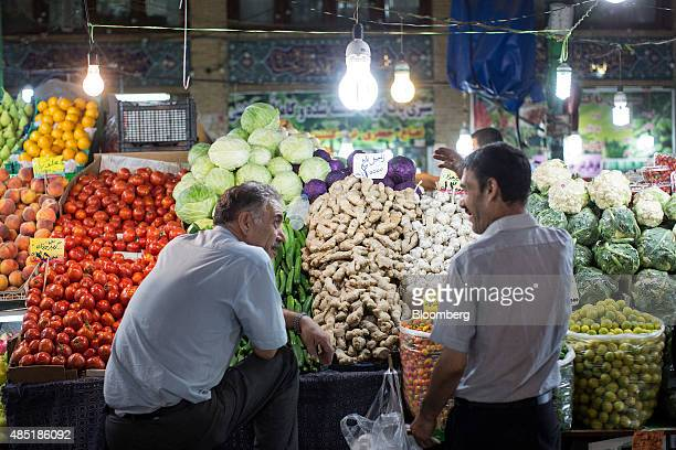 Food vendors chat while waiting for customers at their grocery stalls in Tajrish bazaar in Tehran Iran on Sunday Aug 23 2015 Iran the world's fifth...