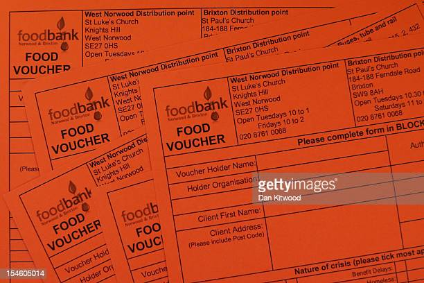 Food vouchers are displayed on a table for the photographer at a Food Bank depot at St Paul's Church in Brixton on October 23 2012 in London England...