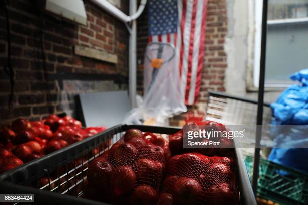 Food waits to be sorted at the Reaching Out Community Services food pantry in Brooklyn on May 15 2017 in New York City The popular Brooklyn food...
