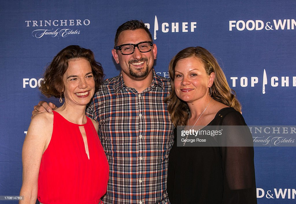 Food & Wine Magazine's Editor-in-Chief Dana Cowin (L) poses with celebrity chef Chris Cosentino and his wife on June 13, 2013, in Aspen, Colorado. The 31st Annual Food & Wine Classic brings together the world's top chefs and vintners in a culinary and beverage celebration.