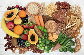 Food with high fiber content for a healthy diet with fruit, vegetables, whole wheat bread, pasta, nuts, legumes, grains and cereals. High in antioxidants, anthocyanins, vitamins and omega 3 fatty acid