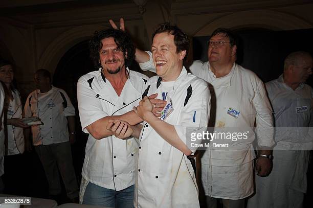 Food writers Tom ParkerBowles and Jay Rayner share a joke with chef Charles Campion during the charity event 'Too Many Critics' at the Royal Exchange...