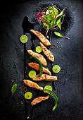 Foodart, fried salmon, lime, black sesame, chard, red chili and green chili pepper