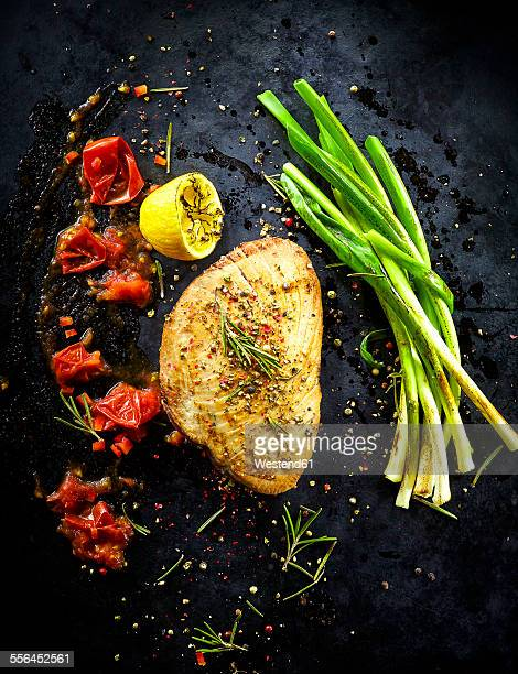 Foodart, tuna with spring onion, tomato, lemon, chili flakes, rosemary and herbs