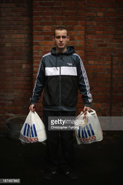 Foodbank client Jonathan Cody poses with his donation of three days food at the Central Liverpool Foodbank at the Frontline Trust on December 3 2012...