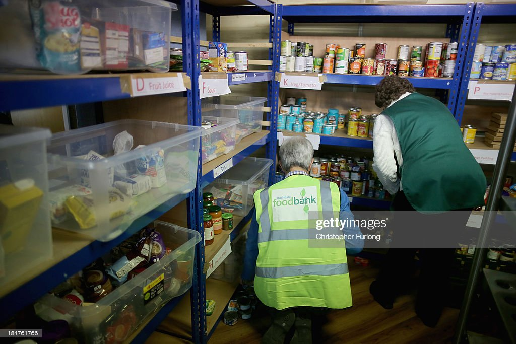 Foodbank volunteers sort through some of the food donated by people to the Rochdale Foodbank on October 16, 2013 in Rochdale, England. Rochdale Foodbank is one of the many emergency food centres run by the Trussell Trust across Britain. The trust has released figures that show demand for it's services has tripled in the last year and they have asked Prime Minister David Cameron to launch an inquiry into food poverty and the surge in foodbank usage.