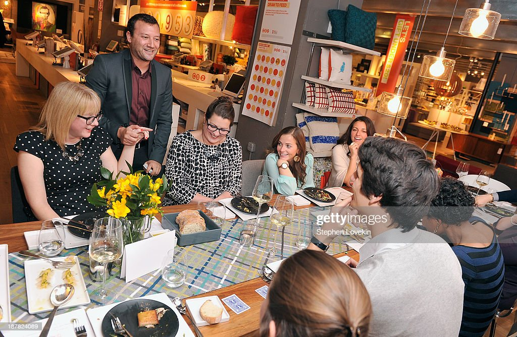 Foodie Magician Josh Beckerman (second from left) entertains guests at The Share Your Table Dinner Party hosted by CB2 and Share Our Strength at CB2 Eastside on November 12, 2013 in New York City.