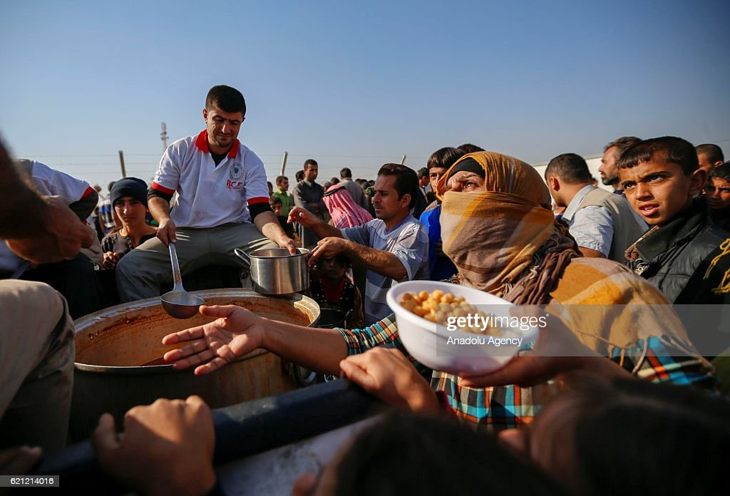 Foods are distributed to Iraqi people at Khazir refugee camp after they had fled from clashes between Iraqi army forces and Daesh terrorists at al-Malayin, al-Samah, al-Khazra, Kirkukli, al-Quds and al-Karama districts, as the operation to retake Iraq's Mosul from Daesh terrorists continues in Mosul, Iraq on November 5, 2016. A much anticipated Mosul offensive to liberate the city from Daesh began midnight of 16th of October 2016.