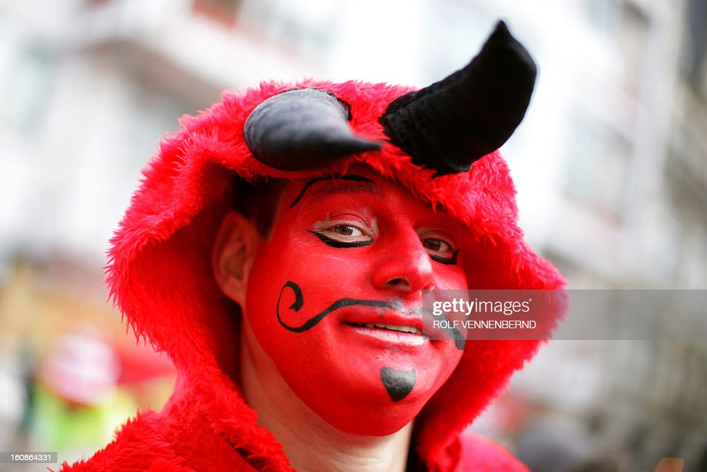 A fool celebrates the beginning of the street carnival in Cologne, western Germany on February 7, 2013, as the hot carnival season was launched. Hundreds of thousands of Germans, mainly in the western Rhine region, crowd the streets to celebrate Women's Carnival Day.
