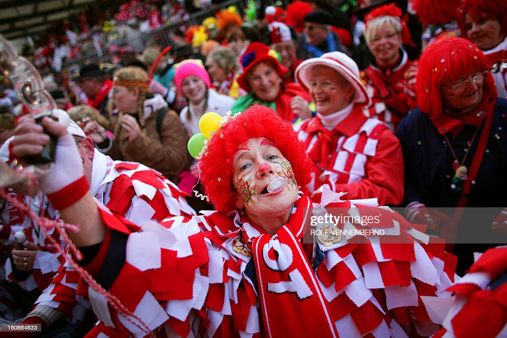Fools celebrate the beginning of the street carnival in Cologne, western Germany on February 7, 2013, as the hot carnival season was launched. Hundreds of thousands of Germans, mainly in the western Rhine region, crowd the streets to celebrate Women's Carnival Day.
