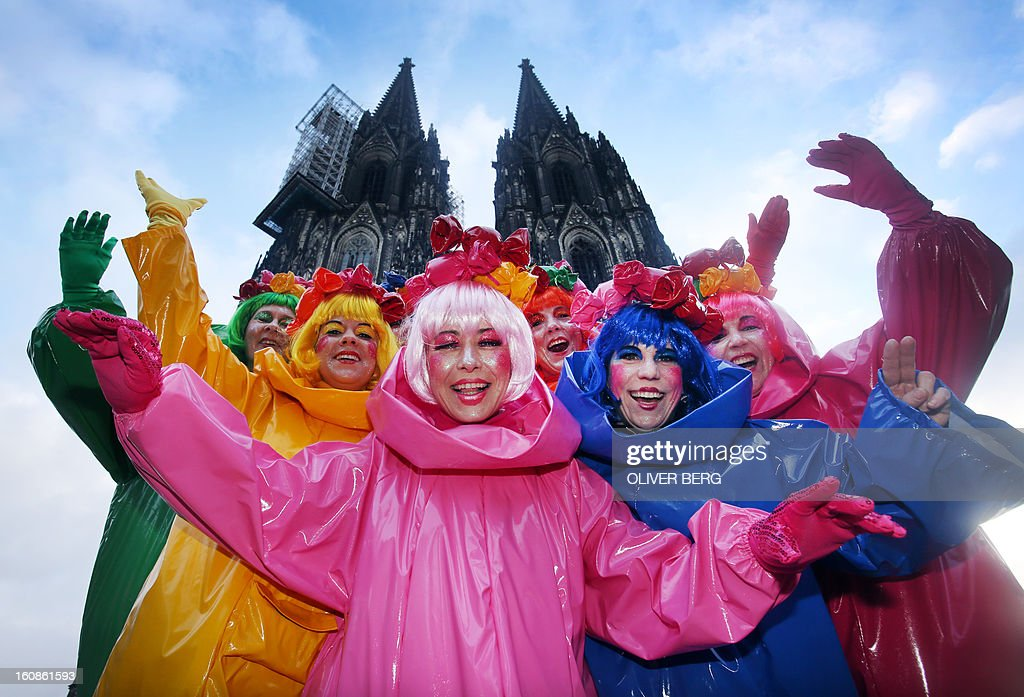 Fools standing in front of Cologne's landmark, the Cathedral, celebrate the beginning of the street carnival in Cologne, western Germany on February 7, 2013, as the hot carnival season was launched. Hundreds of thousands of Germans, mainly in the western Rhine region, crowd the streets to celebrate Women's Carnival Day.