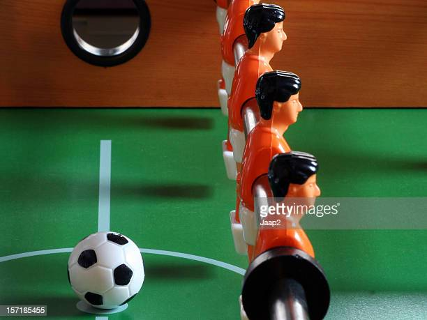 Foosball players facing away from the ball symbolizing disobedience