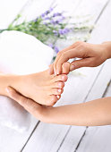 Woman in a beauty salon for pedicure and foot massage.