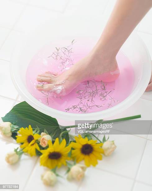Foot in a bowl of water