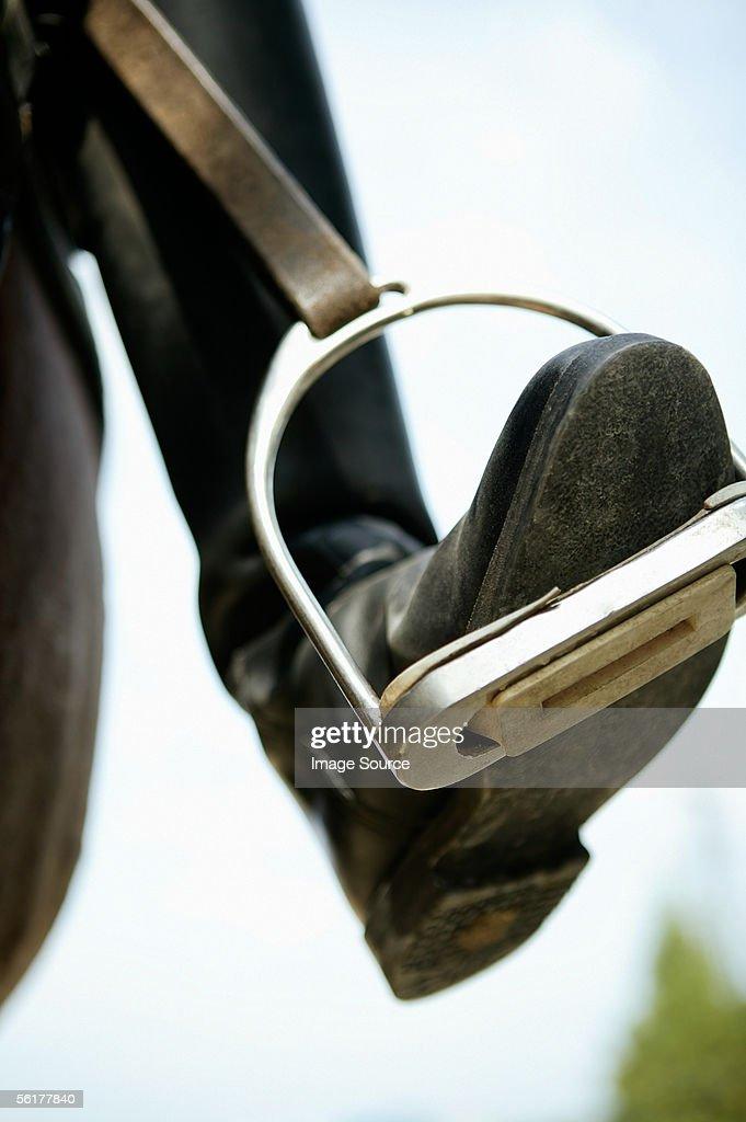 A foot in a stirrup : Stock Photo