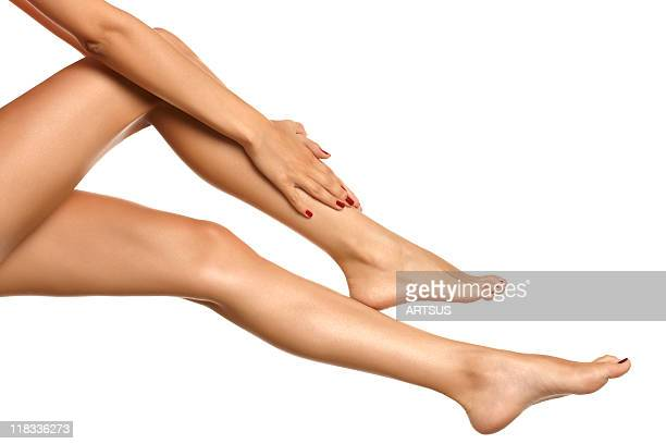 Foot massage of a woman with bare legs
