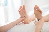 Foot massage treatment in asian spa salon. Close up