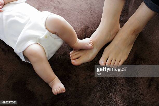Foot of mother and baby