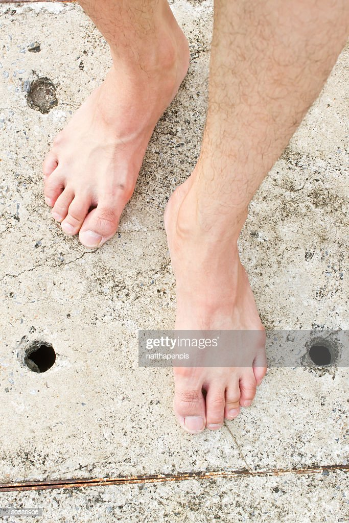 Foot on concrete background : Stock Photo