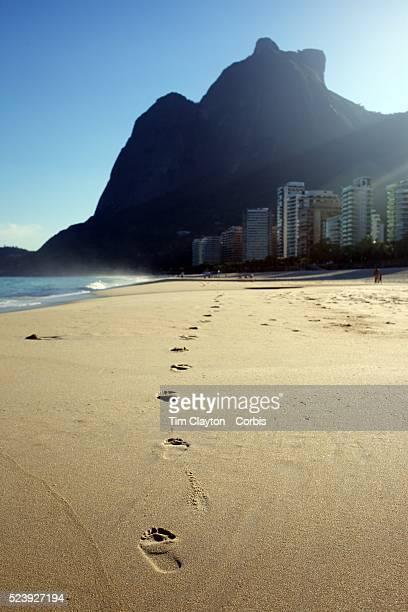 Foot prints in the sand a beach scene at Sao Conrado beach Rio de Janeiro Brazil 7th July 2010 Photo Tim Clayton