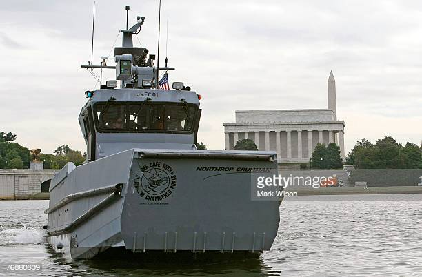 A 41 foot prototype boat named the Joint Multimission Expeditionary Craft is underway on the Potomac River near the Lincoln Memorial during a...
