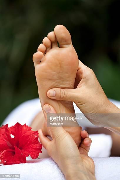 Foot reflexology massage at a spa