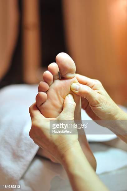 Foot reflexology massage close up