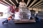 A 14 foot seven inch high Santa Claus is rolled carefully along West Ventura Blvd underneath the Ojai Freeway overpass with only inches to spare The...