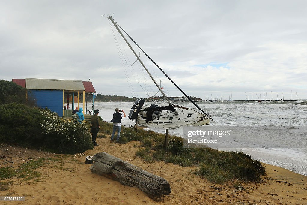 A 40 foot yacht is washed to the shore from its mooring at Shire Hall beach near Mornington Harbour on May 3, 2016 in Melbourne, Australia. Wind gusts of up to 100km per hour are expected in Melbourne and parts of southern Victoria as part of a deep cold front moves across the state.