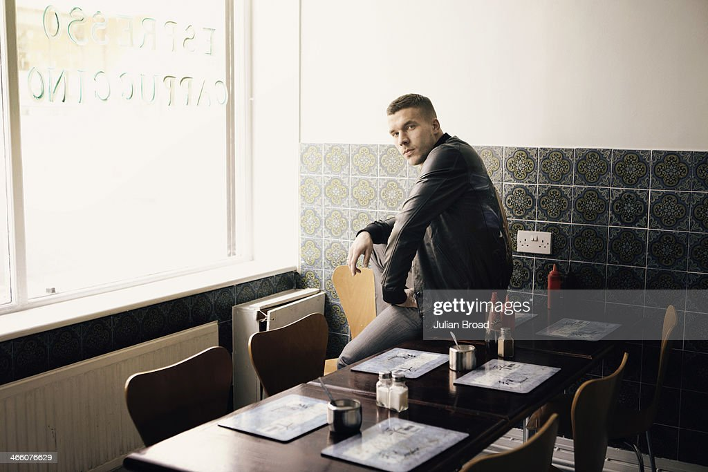 Footabller Lukas Podolski is photographed for GQ on March 28, 2013 in London, England.