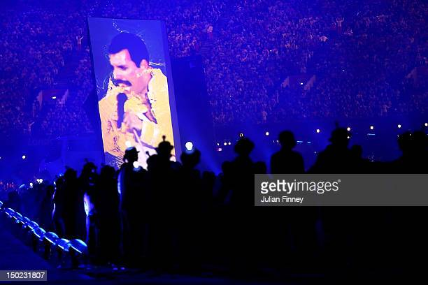 Footage of Freddie Mercury performing live in 1986 is displayed on a big screen inside the stadium during the Closing Ceremony on Day 16 of the...