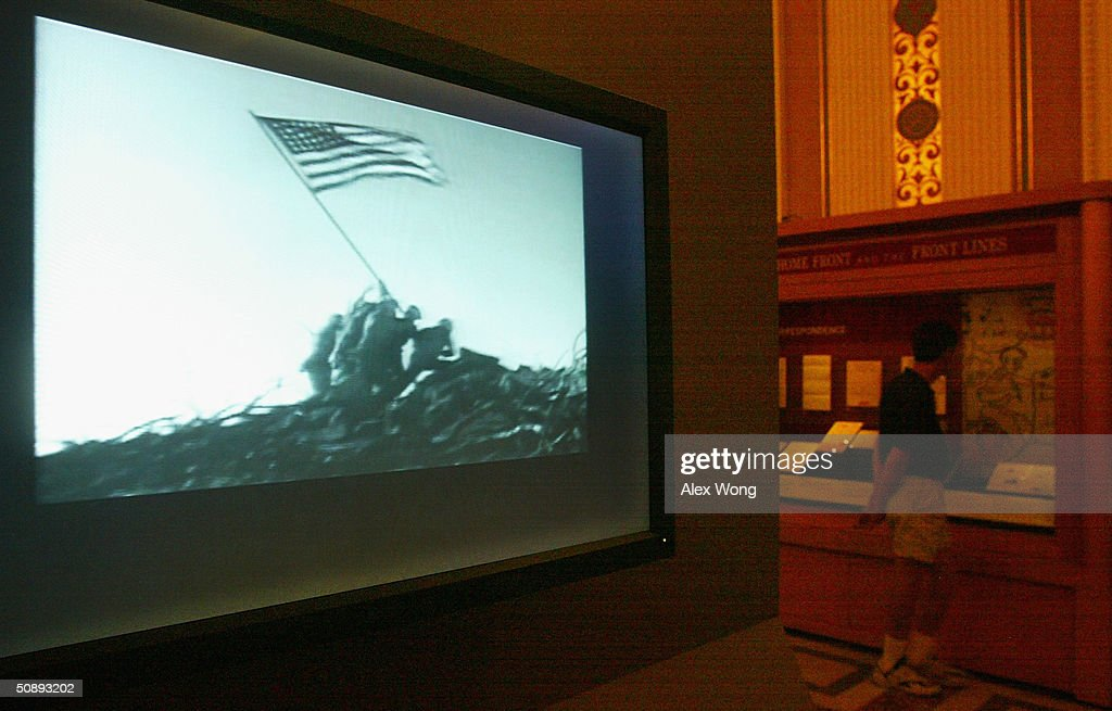 Footage of the scene of US Marines raising a US flag at Iwo Jima during World War II is played at the newly opened 'From the Home Front and the Front...