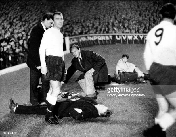 Football 16th October 1963 Highbury London Arsenal v Tottenham Hotspur Spurs' striker Jimmy Greaves goes to help a boy that lies flat out after being...