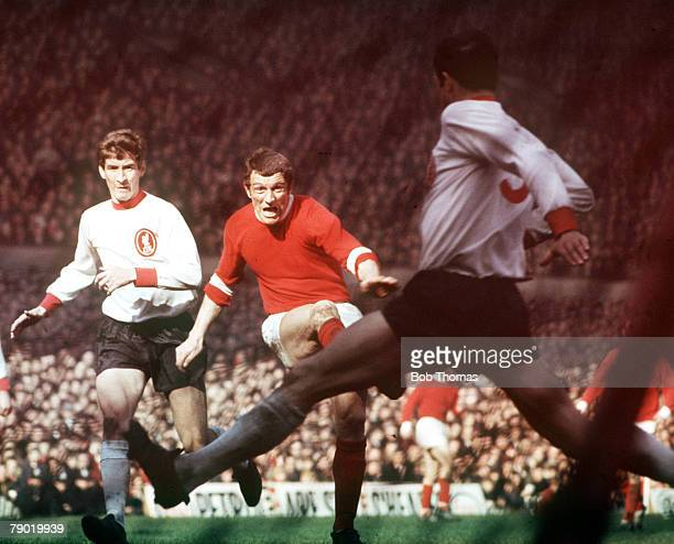 Football 1960's Manchester United's David Herd has his shot blocked by Liverpool defender Ron Yeats during their match