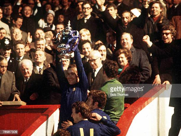 Football 1970 FA Cup Final Replay Old Trafford 29th April Chelsea 2 v Leeds United 1 Chelsea captain Ron Harris holds aloft the trophy after the match