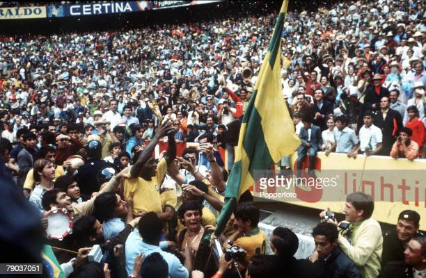 Football 1970 World Cup Final Mexico City Mexico 21st June Brazil 4 v Italy 1 Brazilian star Pele holds aloft the Jules Rimet World Cup trophy to...