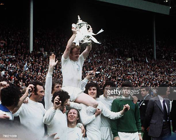 Football 1972 FA Cup Final Wembley Stadium 6th May Leeds United 1 v Arsenal 0 Leeds United captain Billy Bremner is lifted onto the shoulders of his...