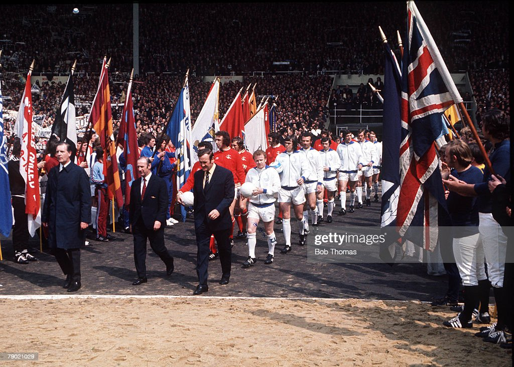 Football, 1972 FA Cup Final, Wembley Stadium, 6th May, 1972, Leeds United 1 v Arsenal 0, The two teams enter the pitch before the kick off, led out by their managers Don Revie (Leeds) and Bertie Mee