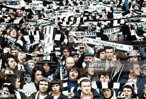 Football 1974 FA Cup Final Wembley Stadium 4th May Liverpool 3 v Newcastle United 0 A huge crowd of Necastle fans cheer on their team waving scarves...