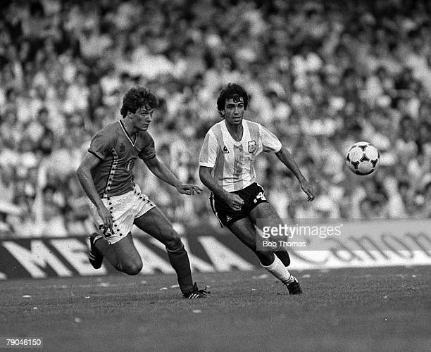 Football 1982 World Cup Finals Barcelona Spain 13th June 1982 Argentina 0 v Belgium 1 Argentina's jorge Olgun plays the ball past Belgium's Alex...