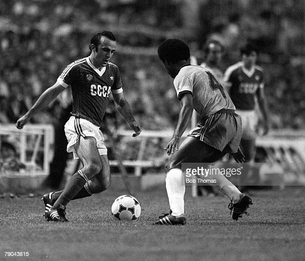 Football 1982 World Cup Finals Seville Spain 14th June 1982 Brazil 2 v USSR 1 USSR's Ramaz Shengelia on the ball faced by Brazil's Luizinho during...