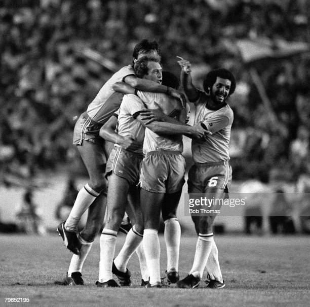 Football 1982 World Cup Finals Seville Spain 18th June 1982 Brazil 4 v Scotland 1 Brazil's Paulo Falcao is mobbed by jubilant teammates as they...