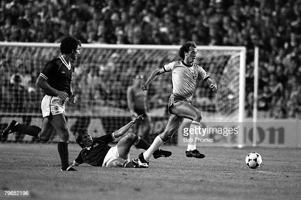 Football 1982 World Cup Finals Seville Spain 18th June 1982 Brazil 4 v Scotland 1 Brazil's Paulo Falcao swerves a tackle from Scotland's Kenny...