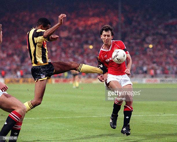 Football 1990 FA Cup Final Replay Wembley 17th May Manchester United 1 v Crystal Palace 0 Manchester United captain Bryan Robson receives a high...