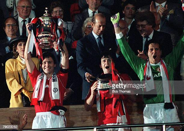 Football 1990 FA Cup Final Replay Wembley 17th May Manchester United 1 v Crystal Palace 0 Manchester United captain Bryan Robson proudly holds aloft...